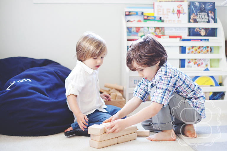 LIfestyle photo of two boys playing with city blocks