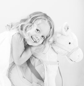 Charlotte Child Rides her rocking horse, photographed in her Charlotte NC home