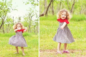Child dances and twirls for photographer's photo in Charlotte orchard