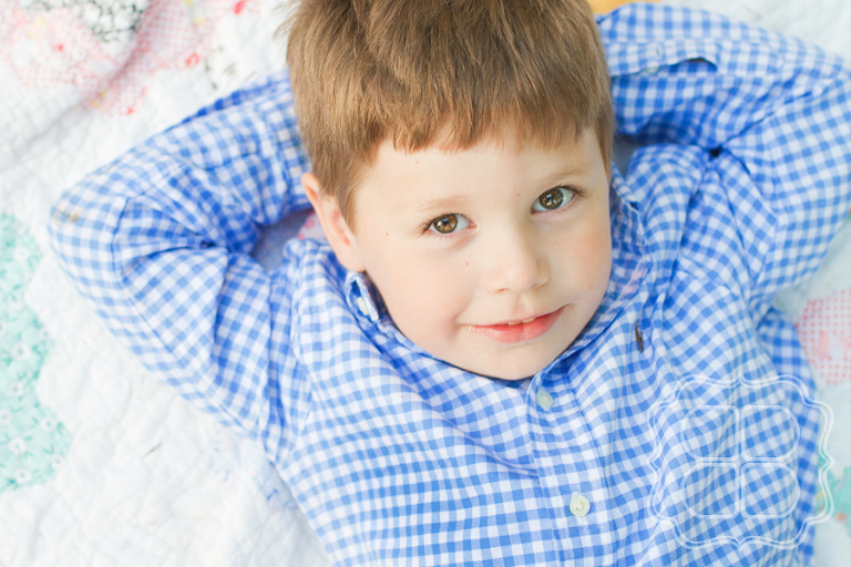 Child portrait of boy on a vintage quilt at Falls Park in Greenville SC
