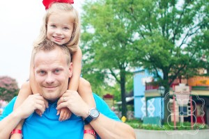 Photo taken at Carowinds in Charlotte of child and her daddy.