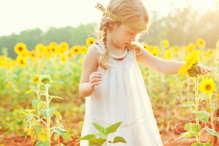Children's photographer in Sunflower field in Charlotte NC