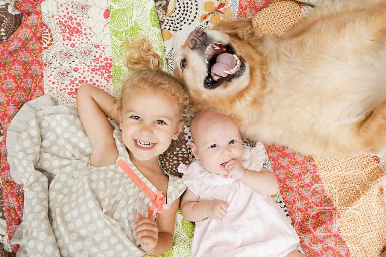 Picture of children with their pet golden retriever