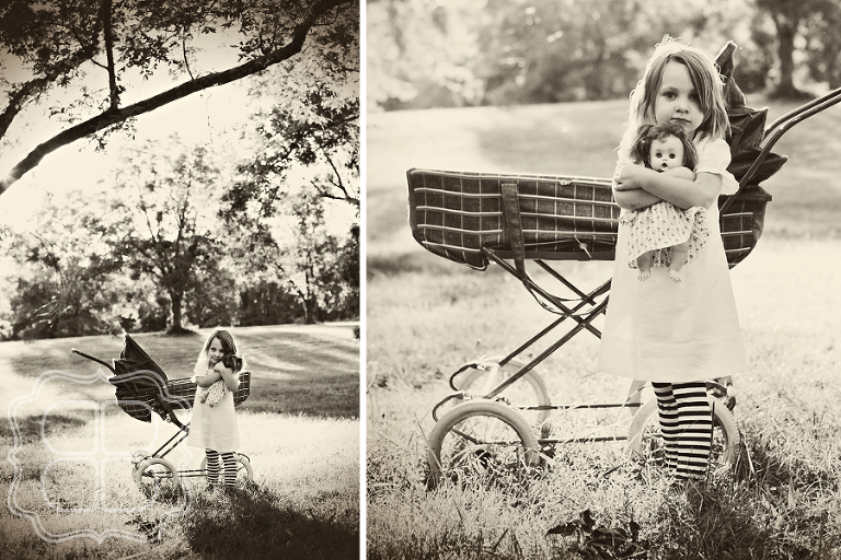 Child poses with creepy baby doll and vintage pram