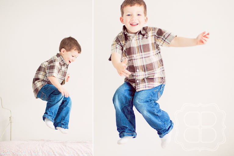little boy jumps on a bed in a photo