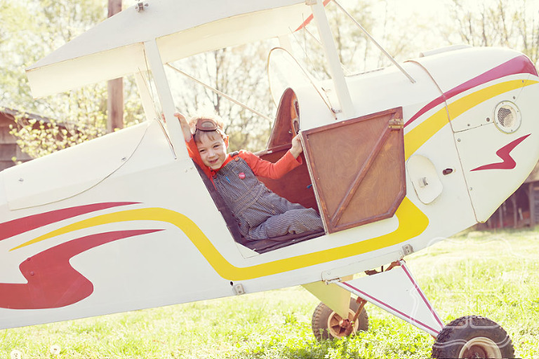 Liam in old airplane