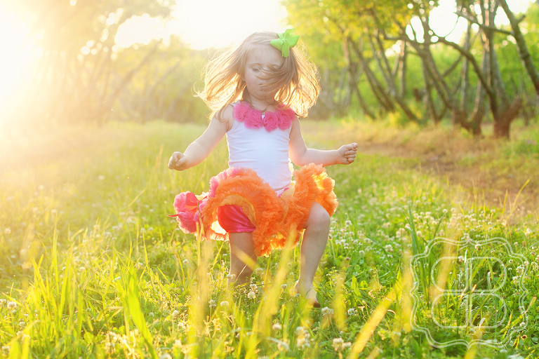 child dances in golden sunlight