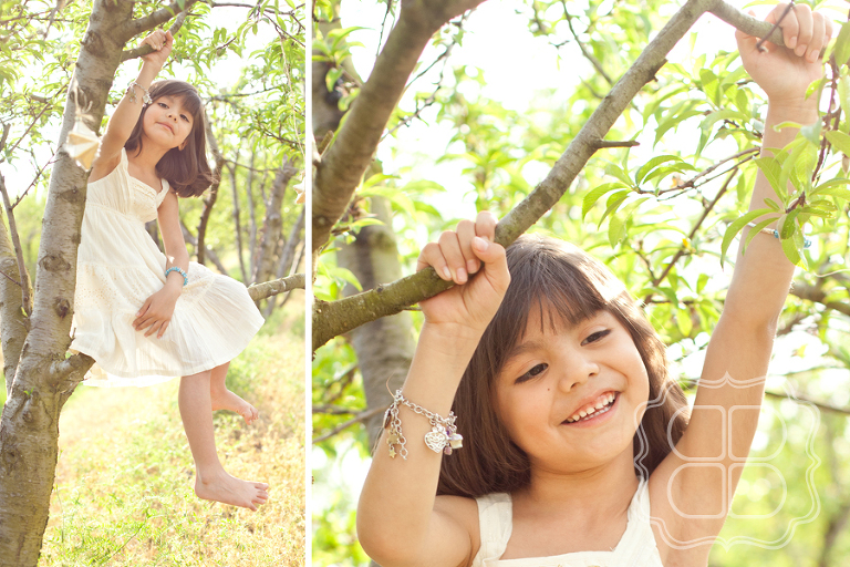 Girl sitting in orchard peach tree