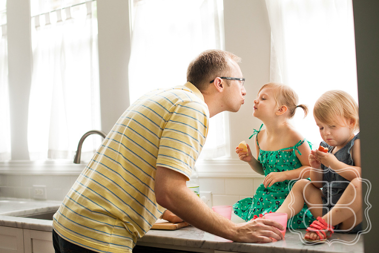 Daddy kisses kis in the kitchen