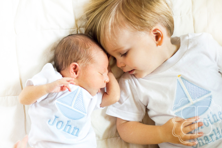 baby brother welcomed by big kid brother