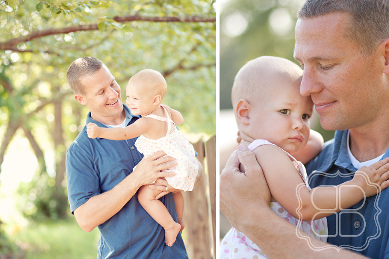 Outdoor portrait of a baby and her dad