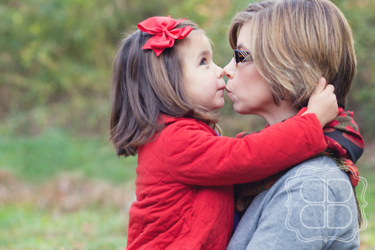 child gives mommy a kissy