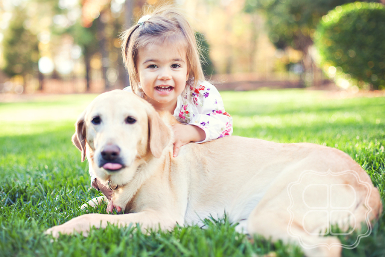 Child and her golden retriever