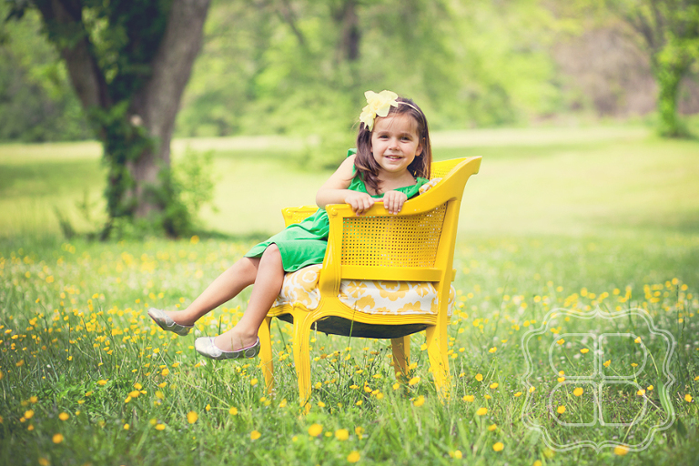 Child portrait in a field with yellow flowers