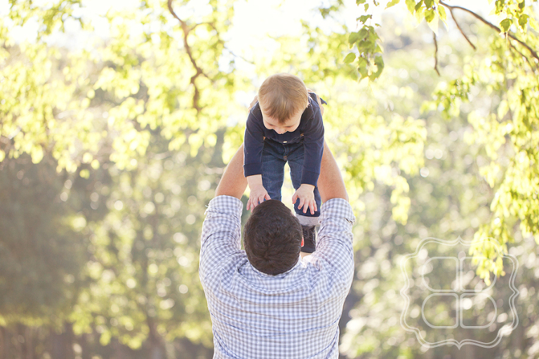Dad playing with child in photo shoot
