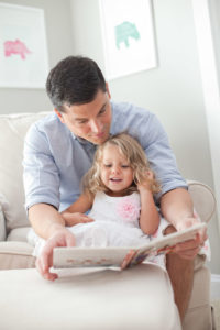 Dad and child read together