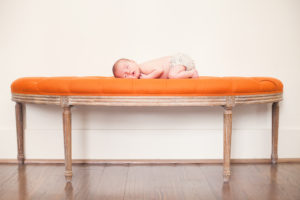 Baby on a tufted bench